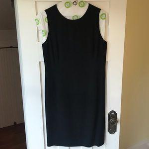 Classic knee-length black sleeveless shift dress